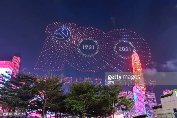 This photo taken on July 1, 2021 shows a centenary signage promoting the 100th anniversary of the founding of the Communist Party of China formed by...