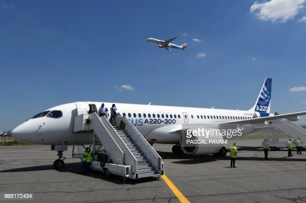 This photo taken on July 10 2018 shows the new Airbus A220300 parked on the tarmac on July 10 2018 at the Airbus delivery center in Colomiers...