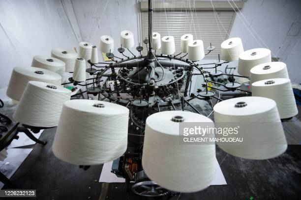 This photo taken on July 10 2020 shows a weaving loom in the Sugar clothes brand factory in Marseille south of France The brand works with a weaving...