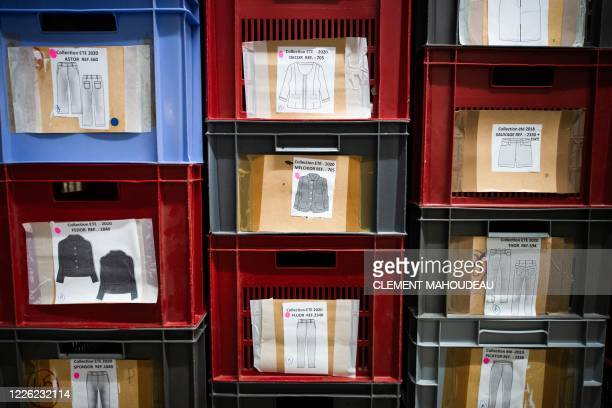 This photo taken on July 10 2020 shows plastic boxes containing different kind of products as part of the Summer 2020 collection in the Sugar clothes...