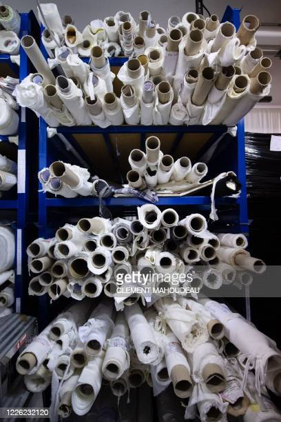 This photo taken on July 10 2020 shows stored rolls of fabric in the Sugar clothes brand factory in Marseille south of France The brand works with a...