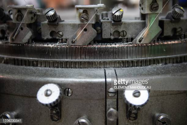 This photo taken on July 10 2020 shows the needles of a weaving loom in the Sugar clothes brand factory in Marseille south of France The brand works...