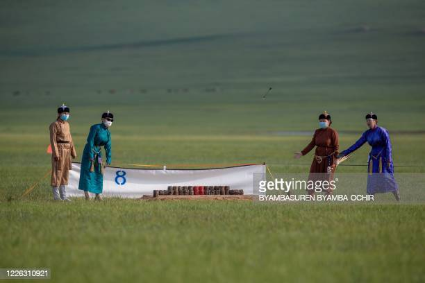 This photo taken on July 11, 2020 shows judges wearing masks during an archery competition at the annual Naadam sports festival near Ulaanbaatar, in...