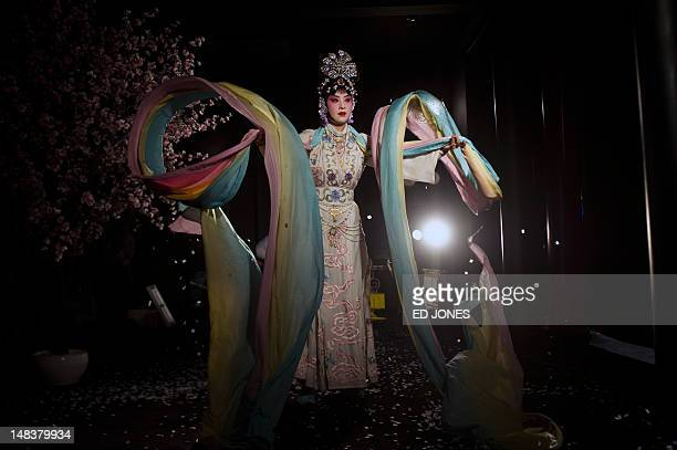 This photo taken on July 13 2012 shows a performer preparing for a curtain call at the Temple Theatre of the Beijing Opera House in Beijing Following...
