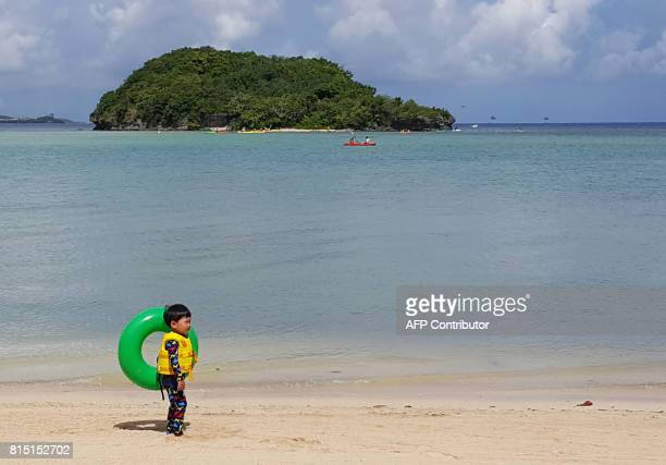 This photo taken on July 14 2017 shows a child on a beach in Guam's capital Hagatna As Guam prepares to celebrate Liberation Day this week political...
