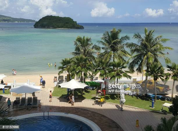 This photo taken on July 14 2017 shows tourists on a beach in Guam's capital Hagatna As Guam prepares to celebrate Liberation Day this week political...