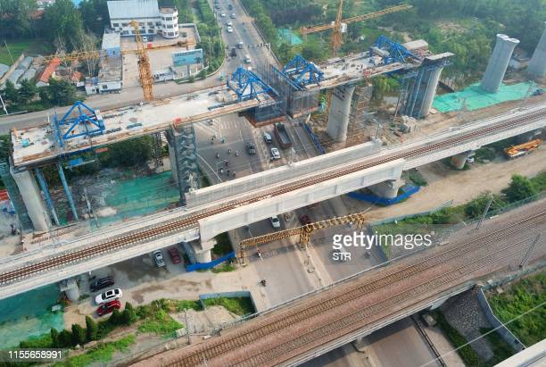 This photo taken on July 14 2019 shows a bridge under construction for China's highspeed rail network in Donghai county in Lianyungang in China's...