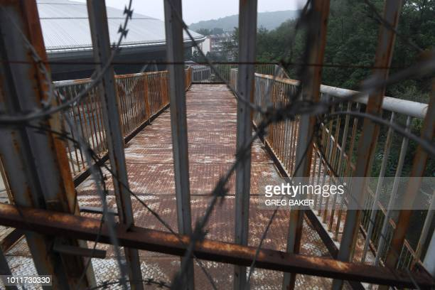 This photo taken on July 18 2018 shows a rusting walkway leading to the BMX track used for the 2008 Beijing Olympic Games in Beijing A decade after...