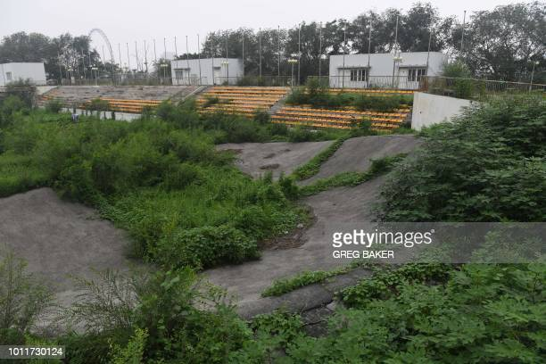 This photo taken on July 18 2018 shows trees and weeds growing on a banked corner of the BMX track used for the 2008 Beijing Olympic Games in Beijing...