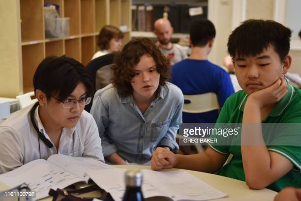 This photo taken on July 19 2019 shows college counsellor Mackenzie Bell speaking with students during a class at Elite Scholars China a boutique...