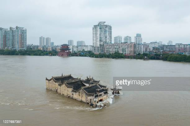 This photo taken on July 19, 2020 shows the Guanyinge temple, a 700-year old temple built on a rock, in the swollen Yangtze River in Wuhan in China's...