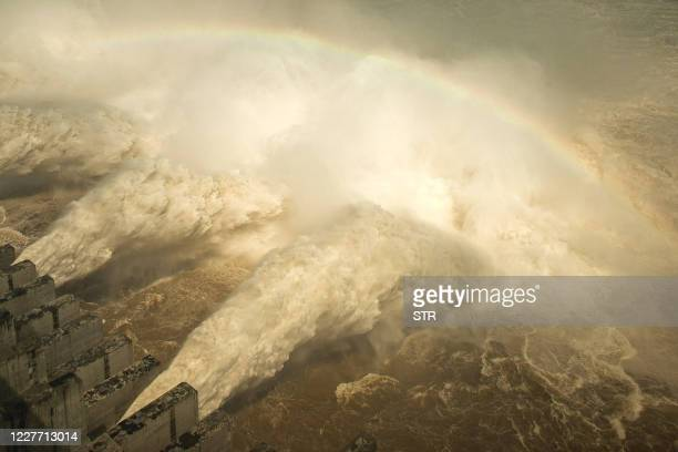 This photo taken on July 19, 2020 shows water being released from the Three Gorges Dam, a gigantic hydropower project on the Yangtze river, to...