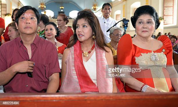 This photo taken on July 2 2014 shows Philippine Senator Ferdinand Marcos sitting with his mother former first lady Imelda Marcos and sister Governor...
