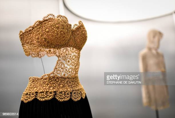 This photo taken on July 2 2018 shows a creation displayed at the exhibition L'Alchimie Secrete d'Une Collection by late FrenchTunisian fashion...
