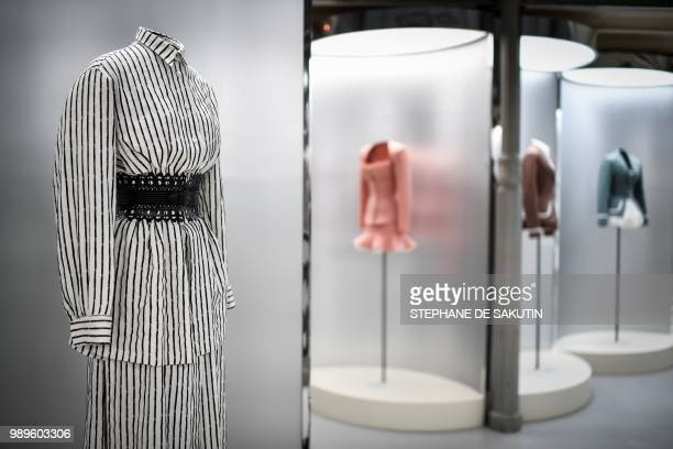 This photo taken on July 2 2018 shows creations displayed at the exhibition L'Alchimie Secrete d'Une Collection by late FrenchTunisian fashion...