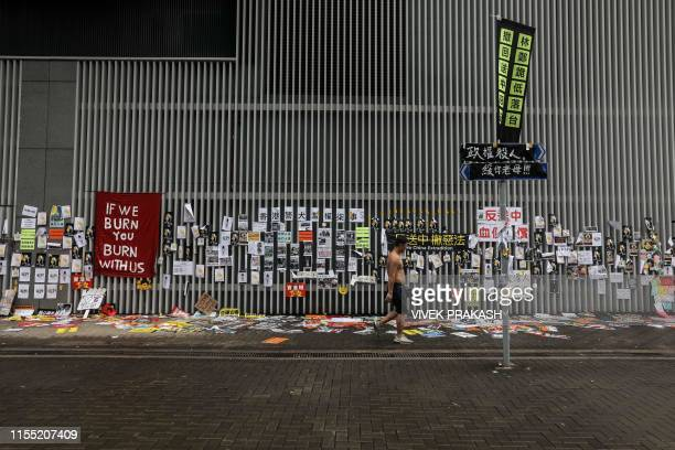 TOPSHOT This photo taken on July 2 2019 shows posters and messages related to protests against the proposed extradition bill pasted to the walls...