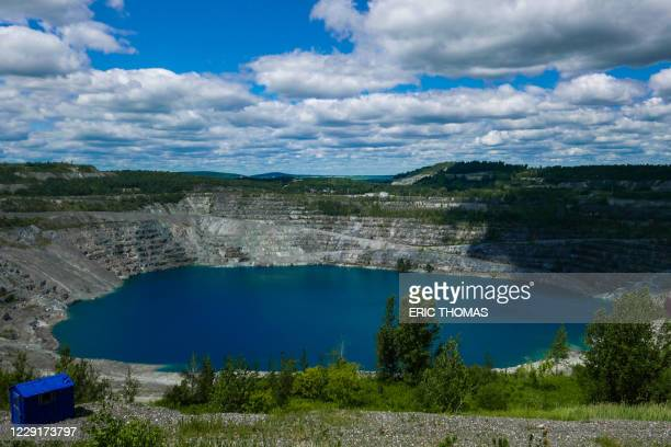 This photo taken on July 21 2020, shows what's left of the Jeffrey mine in Asbestos, Quebec, Canada. - The Quebec city of Asbestos wanted to get rid...