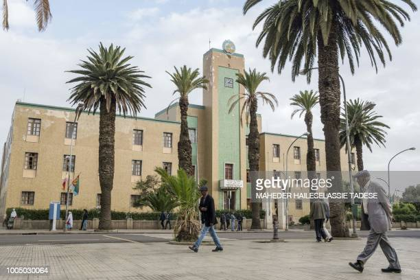 This photo taken on July 21 shows a man walking past a government administration building in the Eritrean capital Asmara. - Located at over 2000...