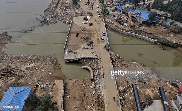 This photo taken on July 23 2016 shows a bridge damaged by recent floodwaters in Daxian village in Xingtai north China's Hebei province As of July 25...