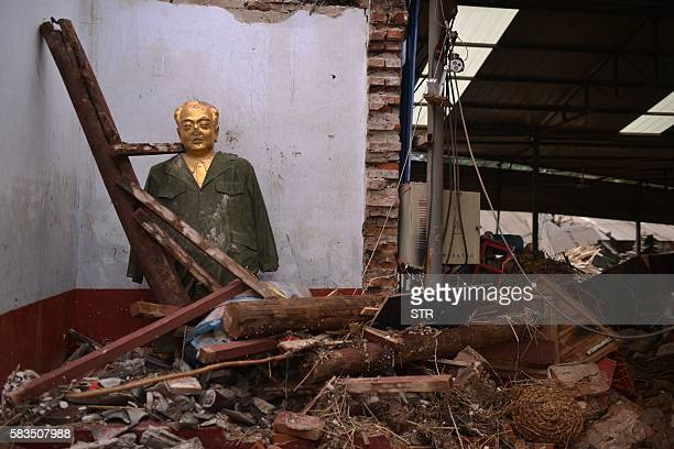 TOPSHOT This photo taken on July 23 2016 shows a house damaged by recent floodwaters in Daxian village in Xingtai north China's Hebei province As of...