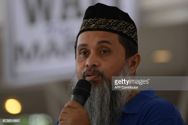 This photo taken on July 23 2017 shows Agkhan 'Binladen' Sharief a peace advocate of the Moro Islamic Liberation Front speaking during a dialogue...