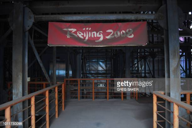 This photo taken on July 23 2018 shows a faded Beijing 2008 sign in the grandstand of the beach volleyball stadium built for the 2008 Beijing Olympic...