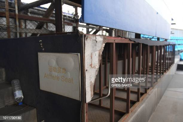 This photo taken on July 23 2018 shows a rundown athlete seating area in the beach volleyball stadium built for the 2008 Beijing Olympic Games in...