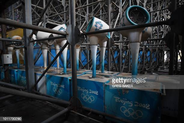 This photo taken on July 23 2018 shows cooling mist fans stored under the grandstand of the beach volleyball stadium built for the 2008 Beijing...