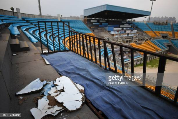 This photo taken on July 23 2018 shows rotting wood on a stand in the beach volleyball stadium built for the 2008 Beijing Olympic Games in Beijing A...