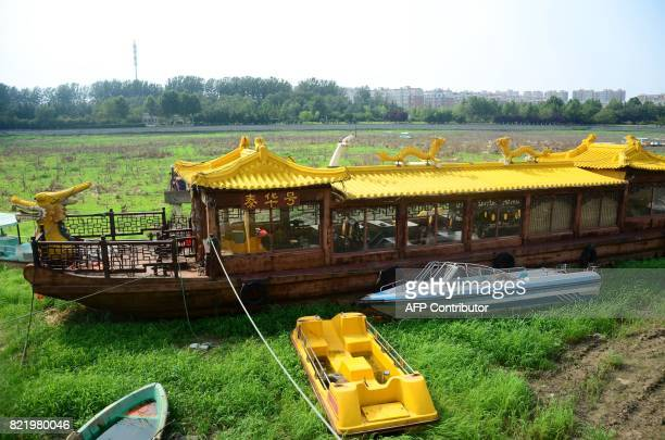 This photo taken on July 24 2017 shows boats sitting in the driedup bottom of the Mihe river in Weifang in China's eastern Shandong province Once...