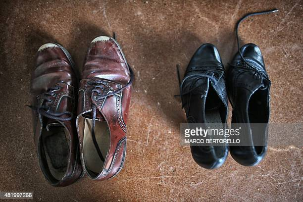 This photo taken on July 25 2015 shows the shoes of the DelReves Company as they prepare for the vertical dance show Guateque at the Reggia of...