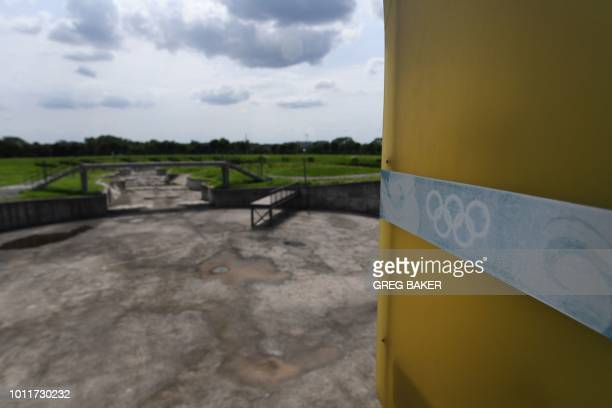 This photo taken on July 25 2018 shows a faded Olympic rings logo beside the whitewater kayaking stadium built for the 2008 Beijing Olympic Games in...