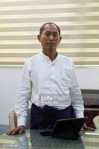 This photo taken on July 25 2018 shows Ko Ko Gyi from the 88 Generation Society posing for a photograph at his party office in Yangon Military...