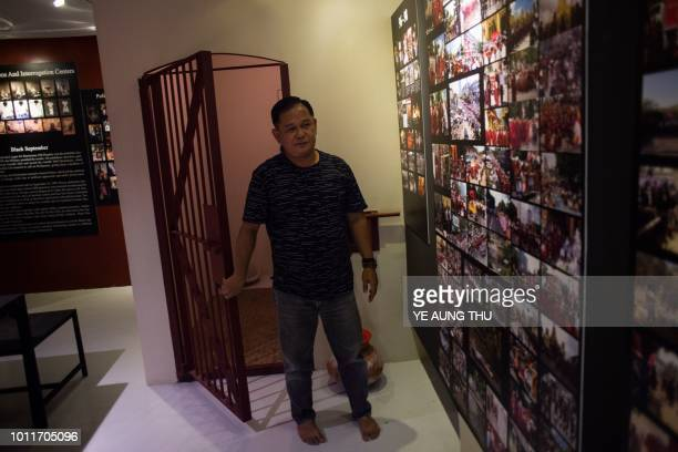 This photo taken on July 25 2018 shows Kyaw Soe Win standing in front of a model of a prison cell at the Assistance Association for Political...
