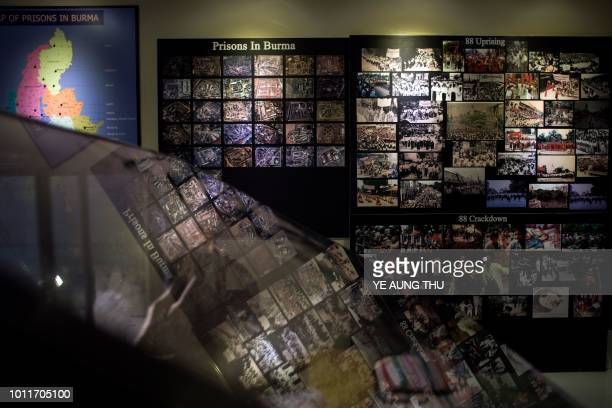 This photo taken on July 25 2018 shows pictures of prisons in Myanmar displayed at the Assistance Association for Political Prisoners museum in...