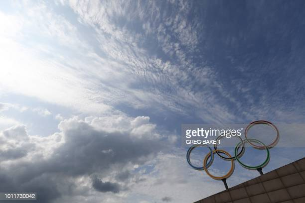 This photo taken on July 25 2018 shows the Olympic rings at the entrance to the canoeing and rowing venue built for the 2008 Beijing Olympic Games in...