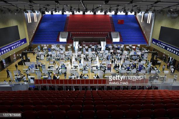 This photo taken on July 25, 2020 shows a general view of a career fair in Zhengzhou, China's Henan province. - China's economy may have rebounded...