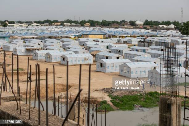 This photo taken on July 26, 2019 shows a general view of the unfinished Mohammed Goni Stadium in Maiduguri where internally displaced persons from...