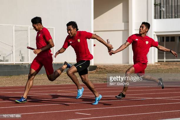 This photo taken on July 27 2018 shows Indonesian sprinter Lalu Zohri taking part in a practice session with his teammates at the Senayan sport...