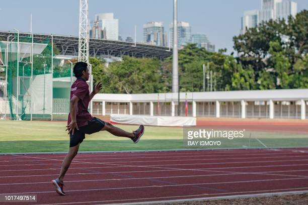This photo taken on July 27 2018 shows Indonesian sprinter Lalu Zohri practicing at the Senayan sport complex in Jakarta ahead of the 2018 Asian...