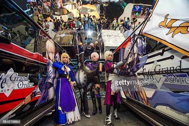 This photo taken on July 28 2016 shows hostesses wearing cosplay outfits posing for photos at 2016 China Digital Entertainment Expo known as...