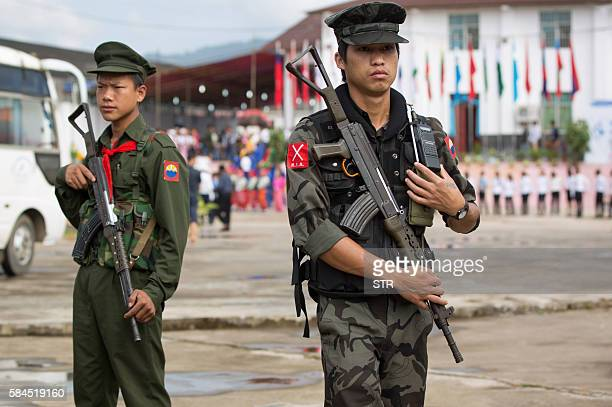 This photo taken on July 28, 2016 shows two Myanmar armed rebels from the Kachin Independence Army securing the compound where Myanmar ethnic rebel...
