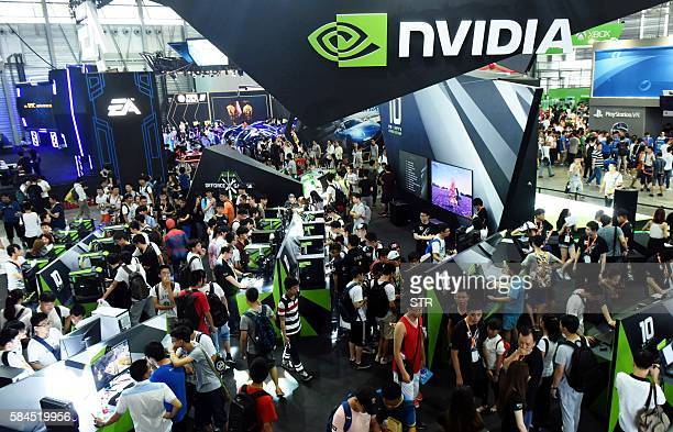 This photo taken on July 28, 2016 shows visitors crowded around the booth of NVIDIA during 2016 China Digital Entertainment Expo, known as...
