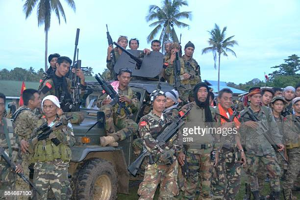This photo taken on July 29 2016 shows hundreds of Muslim rebels from the Moro National Liberation Front gathering at a village as they await orders...