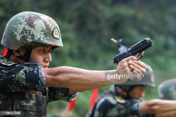 This photo taken on July 29, 2019 shows a Chinese paramilitary police officer taking part in a skill competition in Xiangxi in China's central Hunan...