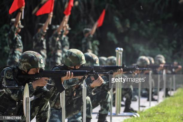 This photo taken on July 29, 2019 shows Chinese paramilitary police officers taking part in a skill competition in Xiangxi in China's central Hunan...