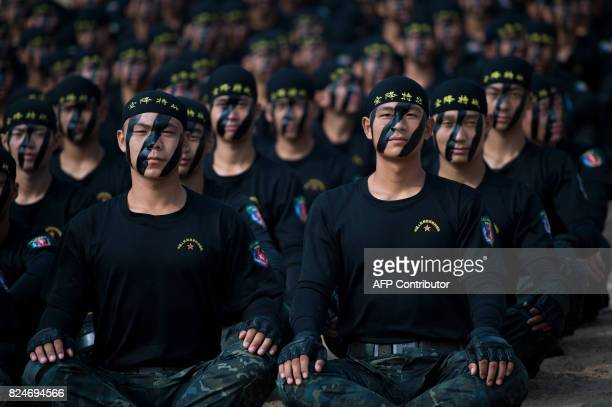 This photo taken on July 30 2017 shows Chinese People's Liberation Army Air Force soldiers clad in face paint taking part in the opening ceremony of...