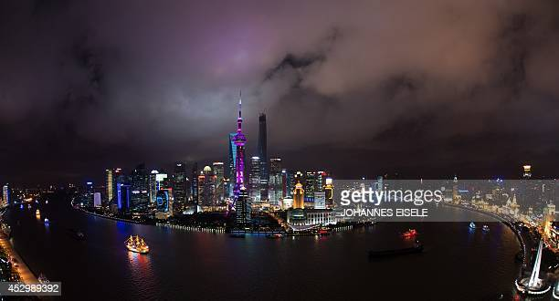 This photo taken on July 31 2014 show clouds above the skyline of the Lujiazui Financial District in Pudong in Shanghai along the Huangpu River The...