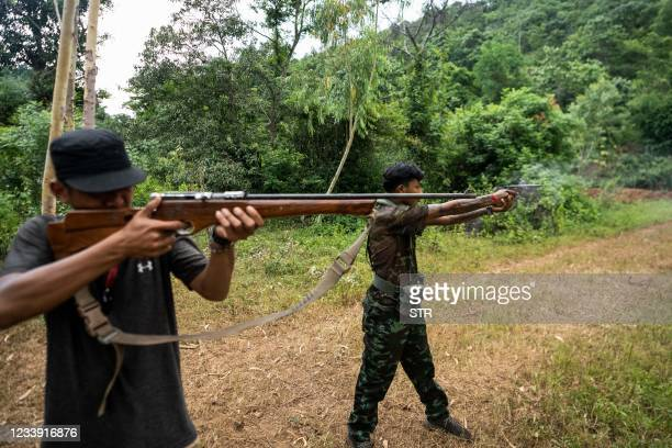 This photo taken on July 6, 2021 shows members of the Karenni People Defense Force taking part in military training at their camp near Demoso in...