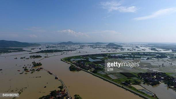 This photo taken on July 7, 2016 shows an aerial view of the town of Shuiyang submerged in floodwaters in Xuancheng, in east China's Anhui province....
